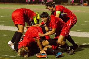 City College Vaqueros celebrate sophomore Jonathan Mora (No. 2) scoring a goal in the final minutes of the game against El Camino-Compton College, Tuesday night Sept. 8, at La Playa Stadium in Santa Barbara. City College beat Compton 1-0.
