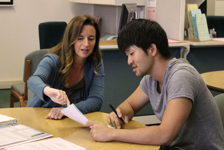 City College Career Counselor Holly Eubank (left) helps student Takuya Higuchi discover his career options in culinary arts, Thursday, Oct. 8, at the Schall Career Center on East Campus in Santa Barbara. The center provides many services to students such as career counseling, work experience classes and resume help.