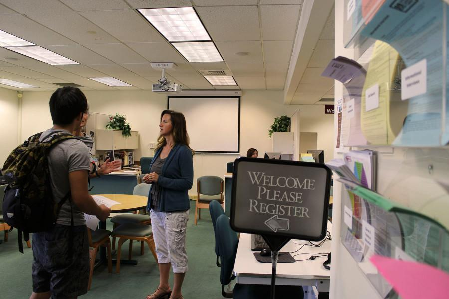 City College Career Counselor Holly Eubank (right) helps student Takuya Higuchi on Thursday, Oct. 8, at the Schall Career Center in the Student Services Building on East Campus in Santa Barbara.