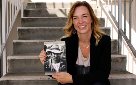City College Alumni Melissa Broughton with her new book 'Cowboy Dad,' Thursday, Oct. 8, on East Campus. The author released her memoir June 2015, offering a candid look at her life with an alcoholic father as well as the lifestyle she led while living on a small town ranch.
