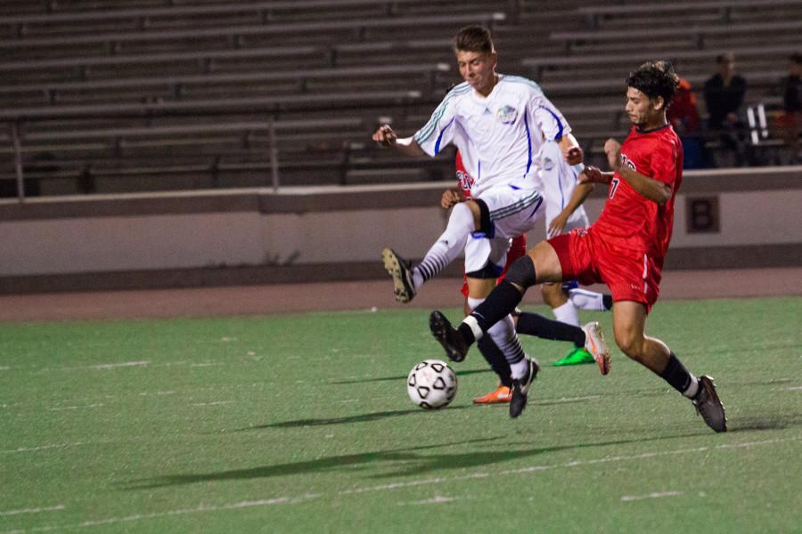 Simon Sebbah (No. 7) steals the ball from an opponent from Oxnard on Saturday, Oct. 27 at La Playa Stadium. Beating the number one team, the Vaqueros walked away with a score of 2-1, and will play their next home game on Friday, Oct. 30.