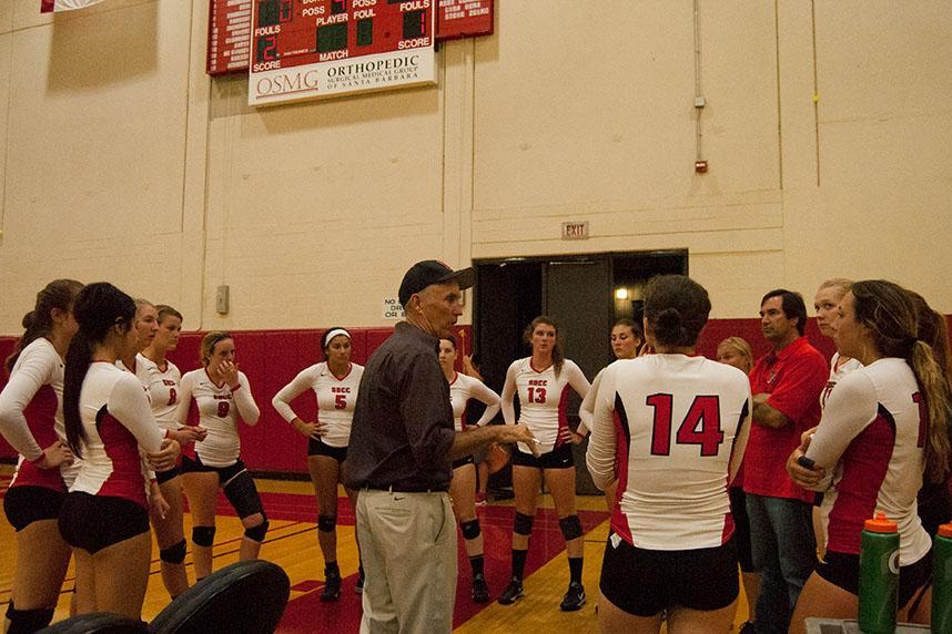 Coach Ed Gover (center) talks with the lady Vaqueros and assistant coach Steve Zelko, after the third set in a match against College of the Canyons on Wednesday night, Sept. 30 in the Santa Barbara City College Sports Pavilion in Santa Barbara. The Vaqueros beat the Cougars, 3-1.
