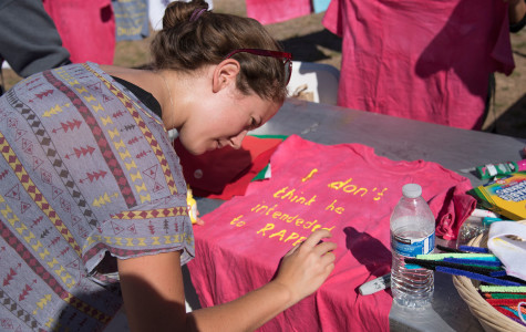 Rachel Bourke, city college student and feminist club member, puts the finishing touches on a t-shirt for the SBCC 2015 Clothesline Project, Monday morning, Oct. 26, in the Friendship Plaza on East Campus. The Clothesline Project is an effort to raise awareness about sexual violence and is presented by Student Health and Wellness and City College Connect, with participation from the Feminist Club, the Rape Crisis Center, the Health and Wellness Center and the Pacific Pride Foundation.