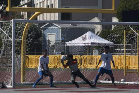 Santa Monica College goalkeeper Weston Adkins (No. 1) intercepts soccer ball while teammates, midfielder Saul Medina (No. 2) and defender Richard Perez (No. 21) look on, at 2 p.m. Friday, Oct. 9 at La Playa Stadium. The game ended in a 1-1 tie.