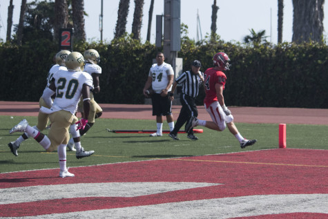 Vaqueros running back Chad Woolsey (No. 24) strides into the end zone for a touchdown with opposing team members in pursuit, bringing the score for Santa Barbara 6 to 7 over rival team LA Valley, at 1 p.m. Saturday, Oct. 17 at La Playa Stadium, Santa Barbara City College. The game ended in a 27 to 28 loss for City College to LA Valley.
