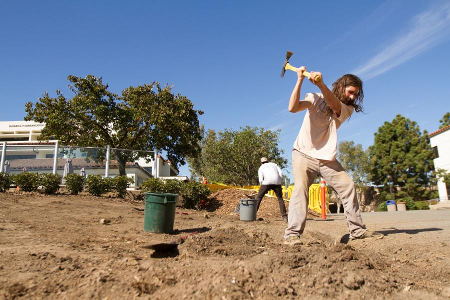 Johnny Tisdal, who is not enrolled at City College, volunteers to help the students with the permaculture project, Sunday afternoon, Nov. 8, on West Campus at City College.The permaculture garden will house perennial fruit trees and an annual vegetable garden.