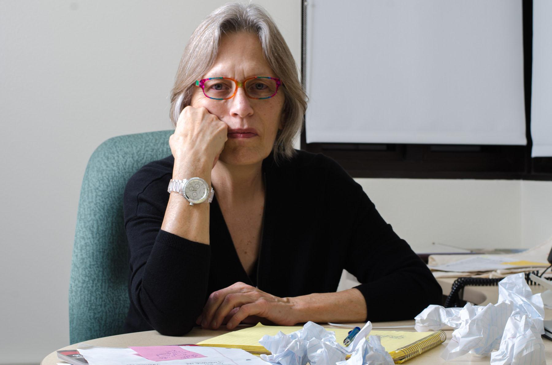 Chella Courington, author and English professor at City College, has recently published her novella 'The Somewhat Sad Tale of the Pitcher and Crow,' Tuesday, Nov. 10, 2015, pictured at her office in the Interdisciplinary Center on West Campus. The story, which shares some parallels to her own life, follows the escapades of two married writers, Tom and Adele, while they try and organize the living and creative space between them. Courington will be reading a piece from her novella on Wednesday, Nov. 18 in the Atkinson Gallery.