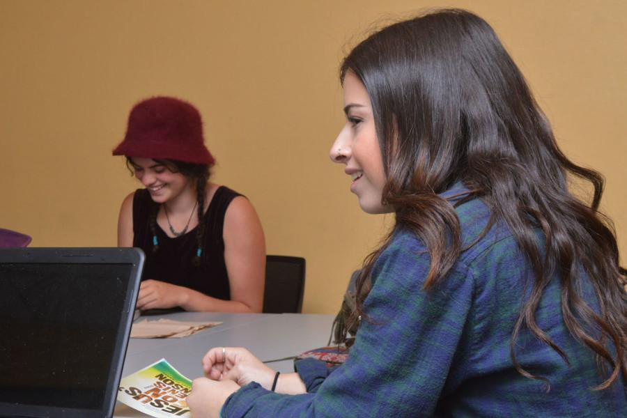Jenna Dorn (right) and Vani Wirick during a meeting for the Creative Writing Club, Nov. 5 in the Campus Center Building at City College. The club is hosting a poerty reading on Friday, Nov. 12 in the BC Forum.