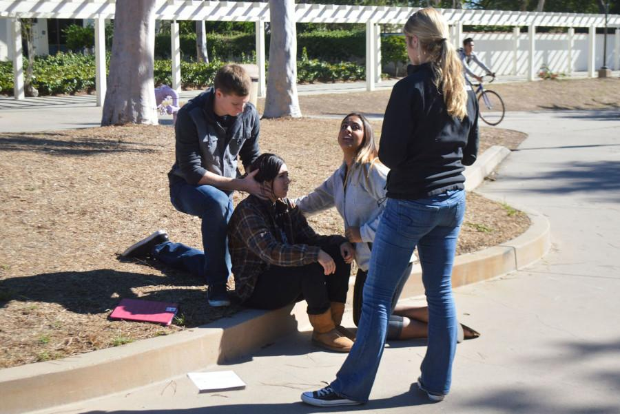From left, Brandon Burkhardt, Alisha Blanco, Jasmine Montes De Oca and Jade Wilson practicing a medical situation during a lab session for the Emergency Medical Technician class, Thursday, Nov. 5, on East Campus in Santa Barbara. The class has six hours of mandatory lab every week, and an additional five hours of lecture.
