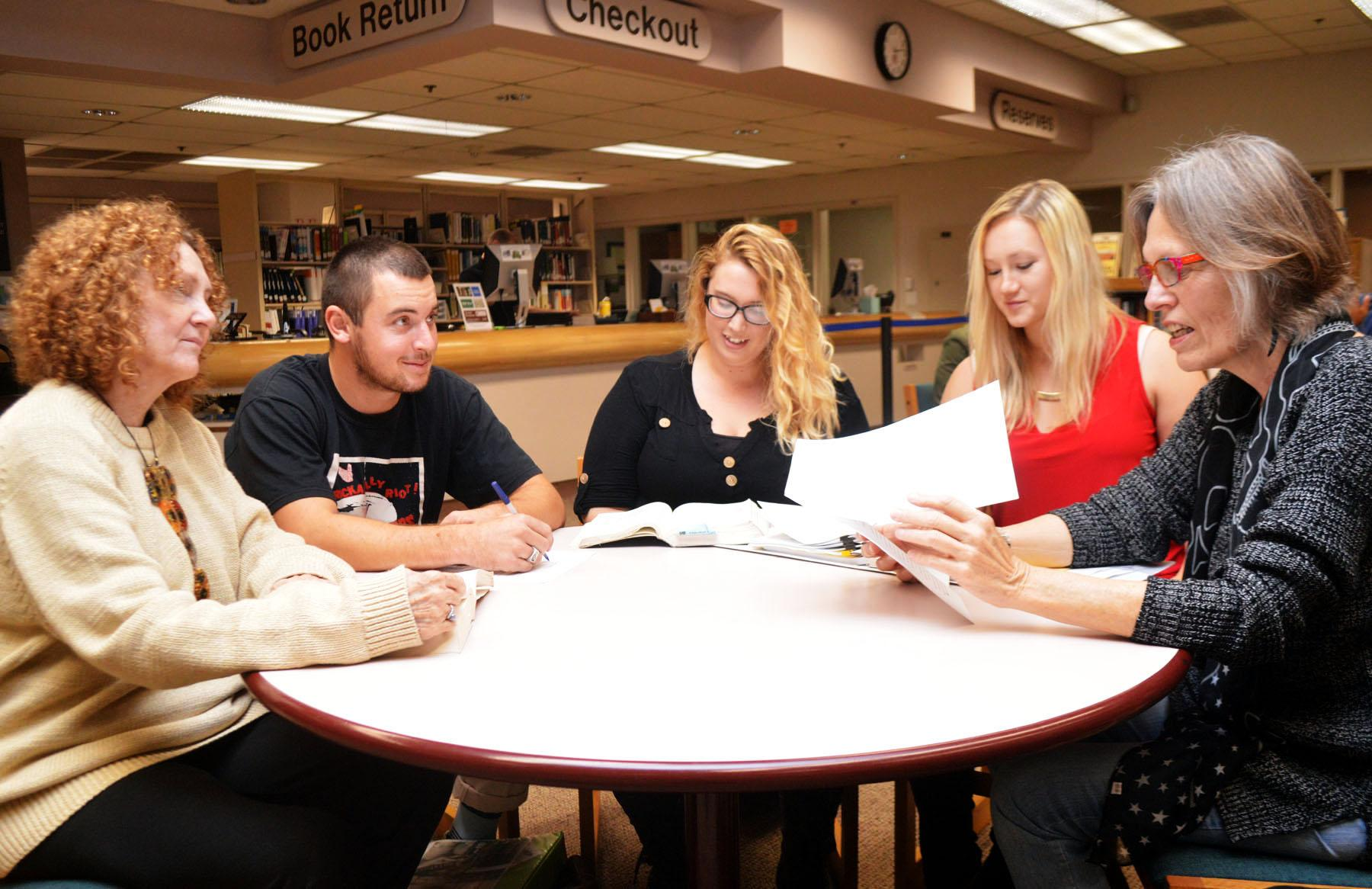 The editors for City College's online literary magazine 'Painted Cave,' from left, Kathryn Lubahn, Grady Olson, Danielle Anderson, Rachel Bower and Faculty Advisor Dr. Chella Courington gather for a meeting, Thursday, Nov. 19 in the Luria Library. 'Painted Cave' publishes bi-annually, and was awarded last month for the best online student-run literary journal of California community colleges.