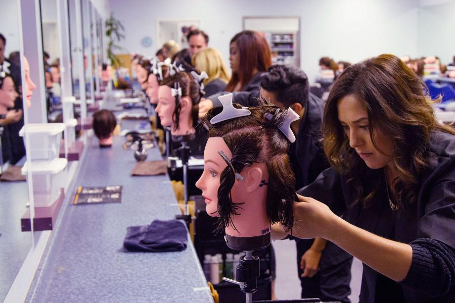 Cosmetology+student+Alma+Rosie+Ortiz+does+a+short+layered+cut+on+her+%E2%80%98Maria%E2%80%99+mannequin%2C+with+fellow+students+enrolled+in+the+revitalized+night+time+program%2C+Wednesday%2C+Nov.+4%2C+at+the+Santa+Barbara+City+College+Cosmetology+Academy%2C+Goleta.+The+night+program+has+been+cancelled+since+2009%2C+and+was+revived+this+past+September.