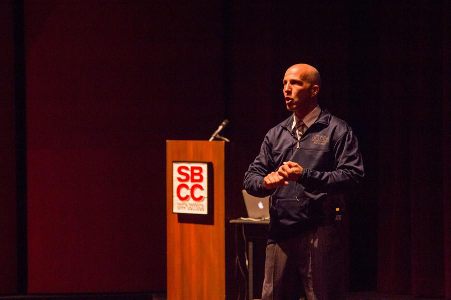 Sergeant Shawn Hill describes the tactics of running, hiding and fighting as tools students should plan to use if faced with an on-campus shooter or assailant, at the 'Active Shooter' presentation on Wednesday, Nov. 4, in the Garvin Theatre on West Campus.