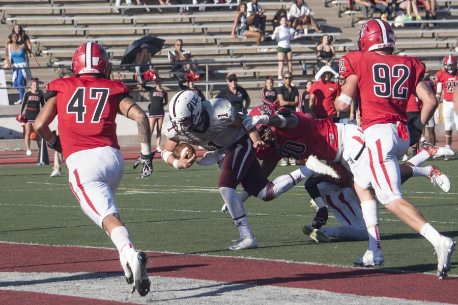 Antelope Valley quarterback Blake Shepherd, (No. 1), crosses into the end zone to score past City College defensive lineman Lordes Jones, (No. 90) tying the game at 38-38 at 1 p.m. Saturday, Oct. 31, at La Playa Stadium. City College later won the game in ovetime 41-38.