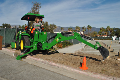Superintendent-President Dr. Lori Gaskin operating a backhoe during the groundbreaking ceremony for a future West Campus Classroom Building, Wednesday, Dec. 2, at City College. Photo courtesy of Joan Galvan.