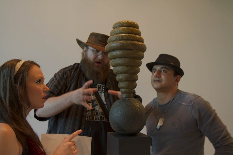 From left, Briar Bates, Michael Lee, and Sami Ibiahin interpret the Hive Sculpture on Friday, Jan. 29, at the Atkinson Gallery art exhibition