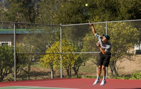 Vaqueros' tennis team member, Andrew Tufenkian, a graduate from Dos Pueblos High School, demonstrates the agility and power of his serve during a preseason warm up match with Westmont College on Tuesday, Jan. 26. Andrew is a transfer student from Cal Lutheran University, returning to his home town after hearing that Santa Barbara City College, was fielding a tennis team after a three year hiatus from intercollegiate competition.