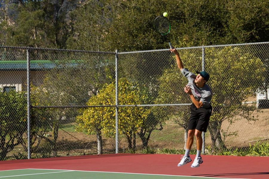 Vaqueros%E2%80%99+tennis+team+member%2C+Andrew+Tufenkian%2C+a+graduate+from+Dos+Pueblos+High+School%2C+demonstrates+the+agility+and+power+of+his+serve+during+a+preseason+warm+up+match+with+Westmont+College+on+Tuesday%2C+Jan.+26.+Andrew+is+a+transfer+student+from+Cal+Lutheran+University%2C+returning+to+his+home+town+after+hearing+that+Santa+Barbara+City+College%2C+was+fielding+a+tennis+team+after+a+three+year+hiatus+from+intercollegiate+competition.