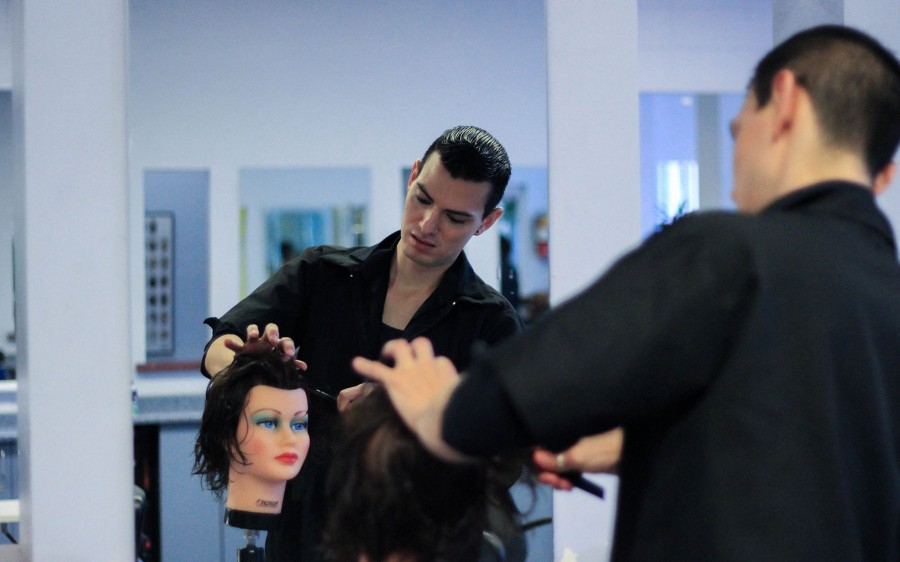 Ramirez practices styling on mannequins on Wednesday, Feb. 25, at the Santa Barbara Cosmetology Academy in Goleta, Calif. Ramirez's main focus in the program is hair cuts and dyes.