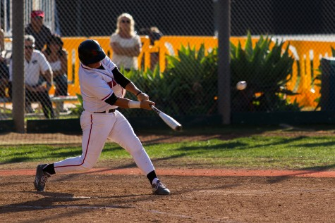 Santa Barbara City College Vaqueros men's baseball team played host to the Condors from Oxnard College on Thursday afternoon, Feb. 25, at Pershing Park in Santa Barbara. Christopher Smutny, Vaqueros' third baseman, gets a well timed hit that helped his team to a 7-2 victory over the Condors.