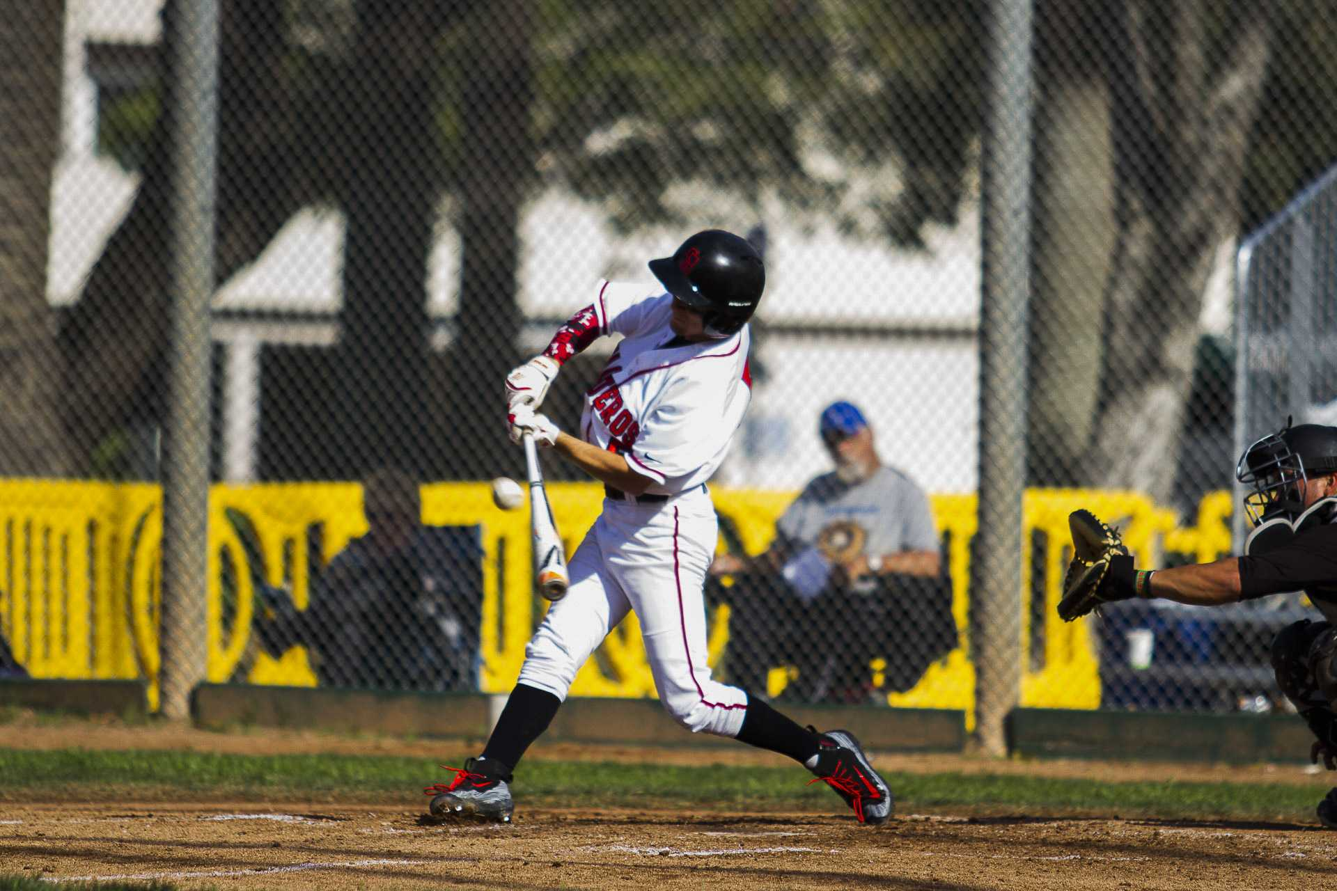 Michael Montpas lines out to right field on Tuesday afternoon, Feb. 23, at the Pershing Park. City College beat Moorpark, 6-2.