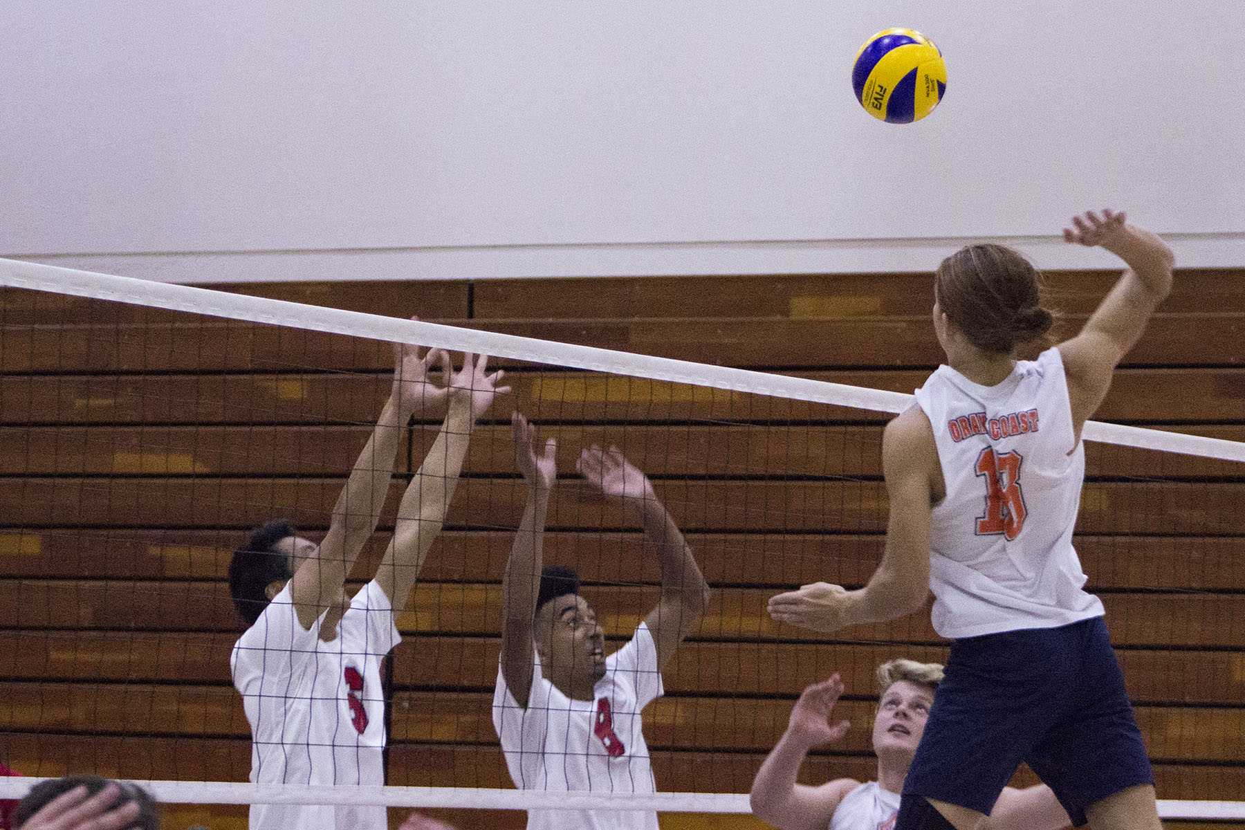 City college Vaqueros Matt Hall (left), and Haward Gomes (middle) unsuccessfully attempt to block Orange Coast College Pirate Will Donald's (right) attack resulting in a kill for the pirates at 1 p.m. Saturday, Feb. 6, in the Sports Pavilion. The Vaqueros lost 0-3.