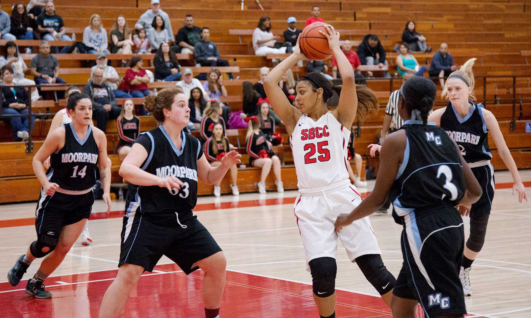 City College lady Vaquero, Destinee King (no. 25), looks for an opening against the Moorpark Raiders at the Sports Pavilion on Saturday, Feb. 13. The   Vaqueros lost 62-53.