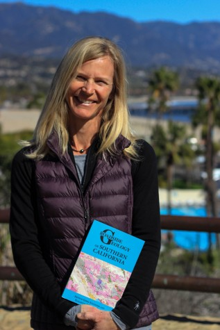 """Elizabeth Gans, geology lab assistant at Santa Barbara City College, with her newly published book """"Roadside Geology of Southern California"""" on Thursday, Feb. 4 at the Winslow Maxwell Overlook on East Campus. The book is a motorist's guide to the geological features found around Southern California."""