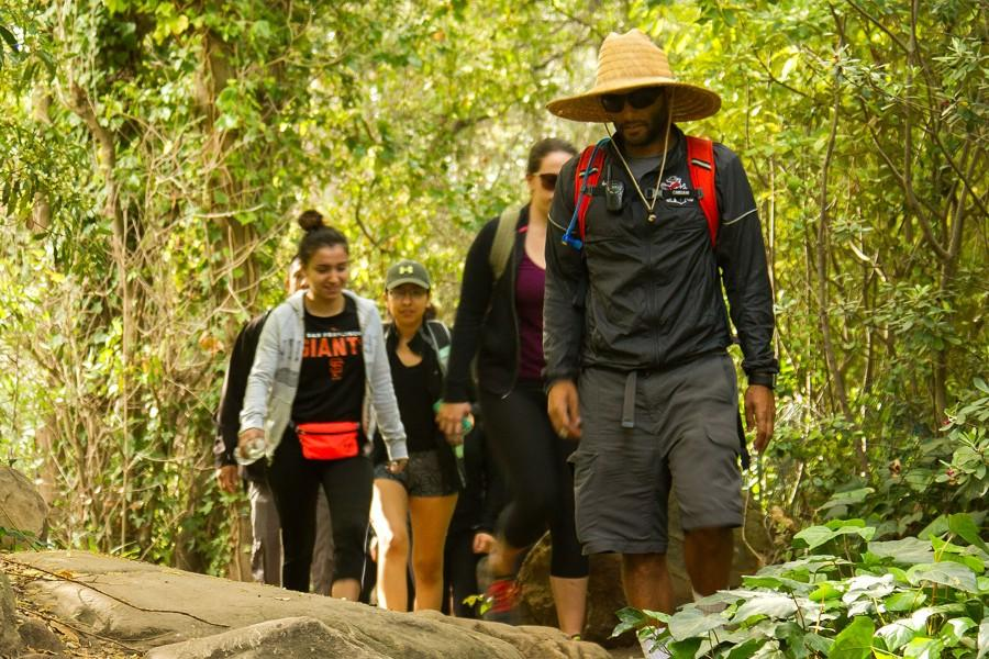 Students start the day's hike off with smiles Friday morning, March 4, at San Ysidro trailhead in Montecito, Calif. The beginning of the hike wanders through a lush residential area before turning into a single track trail with hundreds of feet in elevation change.