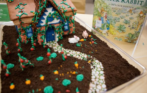 "Lauren Peikert, 24, wins with her rendition of the ""Tale of Peter Rabbit"" at the 6th Edible Book Festival on Wednesday afternoon, March 23, in City College's Luria Library. Peikert's cake won Best representation of scene, line, character, or theme of a book, as well as winging People's Choice and took the cake for Best in Show."