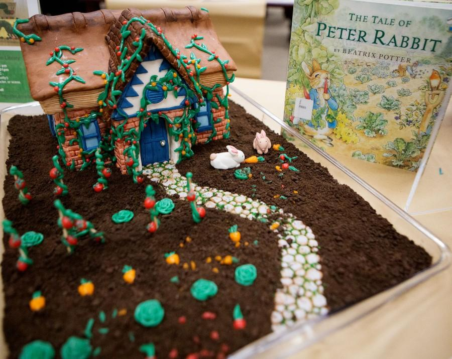"""Lauren Peikert, 24, wins with her rendition of the """"Tale of Peter Rabbit"""" at the 6th Edible Book Festival on Wednesday afternoon, March 23, in City College's Luria Library. Peikert's cake won Best representation of scene, line, character, or theme of a book, as well as winging People's Choice and took the cake for Best in Show."""