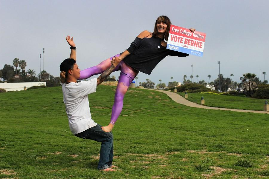 Arianna Thorne, club president of Santa Barbara City College for Bernie Sanders, preforms acrobatic stunts with fellow Bernie supporter, Keenan Conway, to attract students to join the club on Monday, March 1, in front of the Luria Library on the SBCC campus, Santa Barbara, Calif. The club meets on the last Thursday of each month in the Luria Library at 6 p.m.