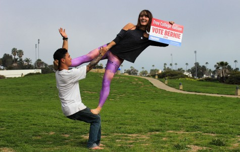Arianna Thorne, club president of Santa Barbara City College for Bernie Sanders, performs acrobatic stunts with fellow Bernie supporter, Keenan Conway, to attract students to join the club on Monday, March 1, in front of the Luria Library on the SBCC campus. The club meets on the last Thursday of each month in the Luria Library at 6 p.m.