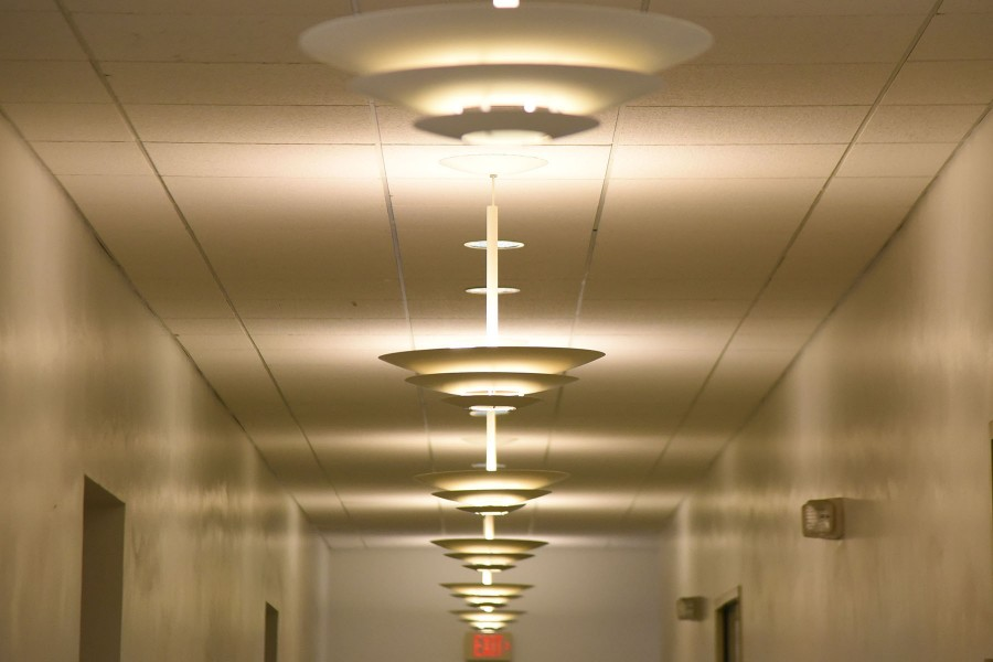 The Administration Building's inefficient and outdated lighting still hang from the ceilings on Friday, March 4, at City College. The lights are slated to be replaced with longer lasting eco-friendly lights that will save hundreds of thousands of dollars over time.