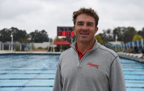Swim coach Brian Roth stands near the pool during City College's first swim meet on Saturday, March 5, 2016, at the Ventura Aquatic Center in Ventura Calif. Roth has been City College's swimming and water polo coach since 2014 and before that he had coached many other swim teams in the Santa Barbara area.