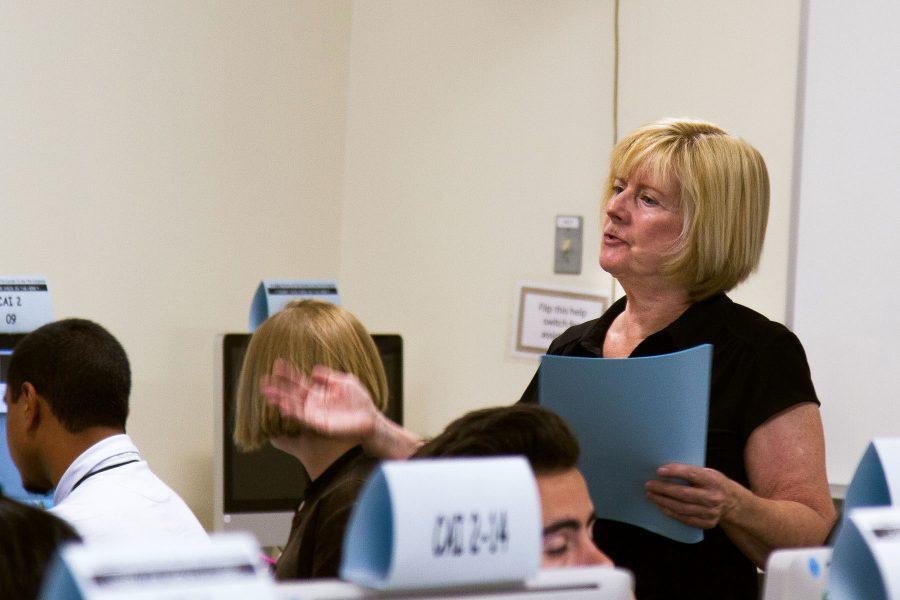 City College English professor, Kathy Molloy, helps accelerated English 100/110 students prepare for their final portfolio projects on Tuesday, April 6, in the Cartwright Learning Resource Center tutor labs at City College in Santa Barbara. Molloy was this year's California Area C recipient. Recipients of the Hayward Award receive a plaque and a $1,250 cash award.