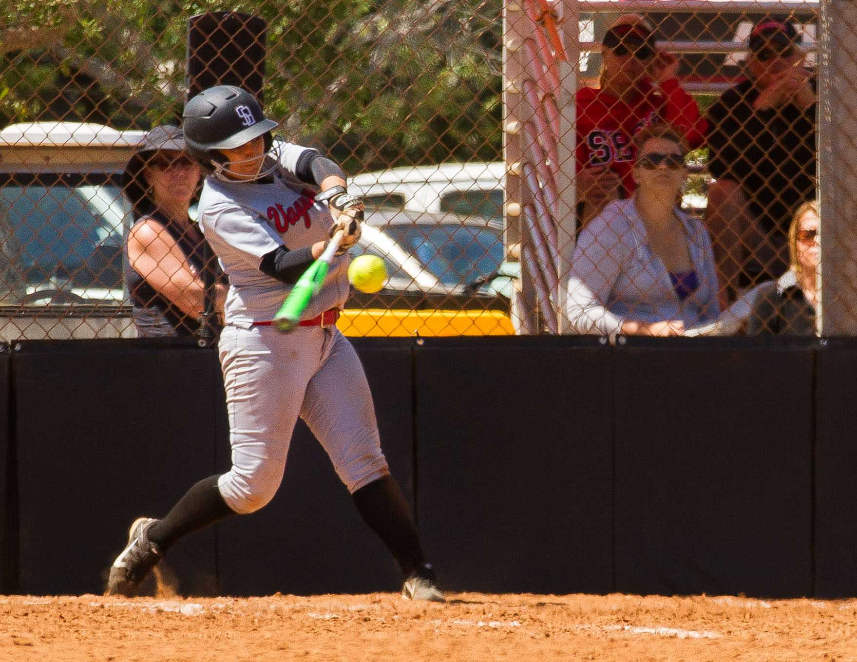 Christal Vierra gets a solid single through the left side in the second inning, on Tuesday, April 5, at Pershing Park in Santa Barbara, where the City College women's softball team hosted a double-header against Moorpark College. The Vaqueros split the double-header W (4-3), L (5-1).