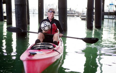 John Sisterson, city college soccer coach and kayking instructor, gets ready to kayak with his students on Tuesday morning, April 26, at the Leadbetter Beach docks in Santa Barbara. Sisterson has been teaching both men and women's soccer at City College for 12 years and introduced the kayaking class to the college 10 years ago.