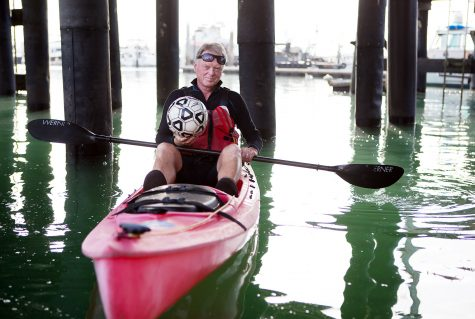 John Sisterson, city college soccer coach and kayking instructor, gets ready to kayak with his students on Tuesday morning, April 26, at the Leadbetter Beach docks in Santa Barbara. Sisterson has been teaching both men and women