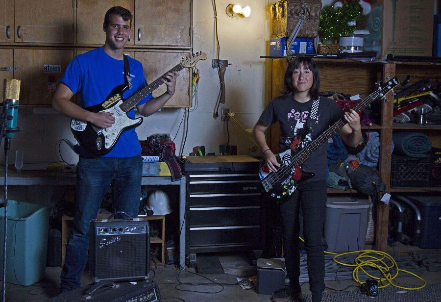 "The band ""Gloom Me"" consisting of Ethan Jones, lead guitarist and vocalist, and bassist Stephanie Luna practice new songs on Tuesday, April 12, in Luna's garage in Goleta. The Pokemon ska alternative hardcore band originated from a band lottery at the Funzone. Not shown is band member Sydney Hengst."
