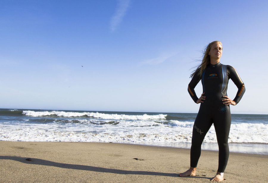 City College swimmer Kristina Hill stands on the beach on Thursday, April 14, at Leadbetter Beach, Santa Barbara. Hill not only broke the school record in the 1000 yard freestyle at the last conference, but she has previously won the open water race, Escape from Alcatraz.