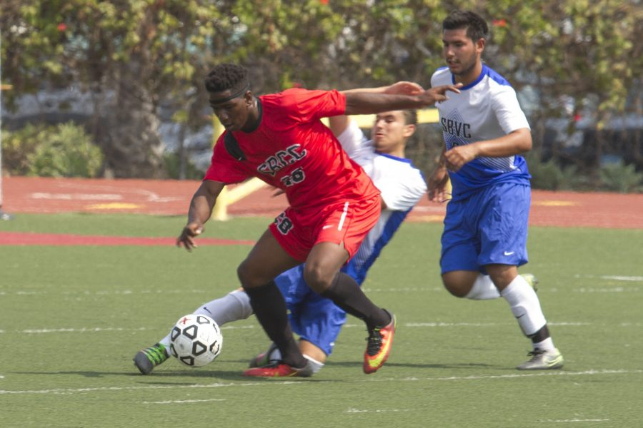 City College Vaquero Sadiki Johnson maintains possession of the ball as Brandon Solorzano (left) and Fernando Ramirez from San Bernardino Valley College attempt to steal it. The match took place Friday, Aug. 26 City College's La Playa Stadium. The Vaqueros were defeated 0-2.