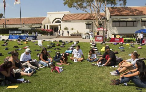 "Miguel Cruz, president of the Still I Rise Writing Club (seated third from right), leads a discussion of depression and suicide during a writing circle on Tuesday, Sept. 20, during the ""Send Silence Packing"" event in front of the Luria Library. ""I'm safe here; I feel loved,"" said Cruz."