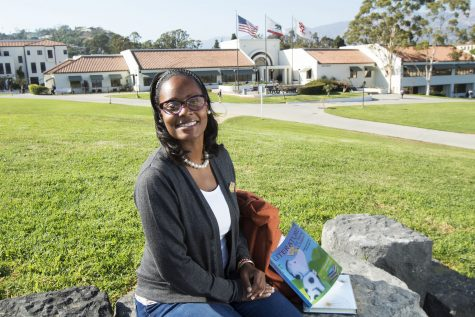 Devona Hawkins relaxes on the hill over-looking the Luria Library before her evening class on Thursday Sept. 8, on City College's West Campus. Hawkins is the first full-time professor that has been hired for the early childhood education department at City College in several years.