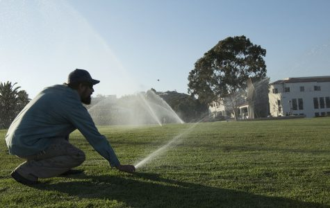 Mark Broomfield, ground maintenance supervisor for City College, demonstrates the daily recycled-water routine on Thursday, Sept. 8, on the West Campus lawn. The sprinklers normally go off on a timer around four a.m. before students arrive for their classes.