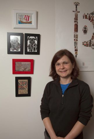 Tara Carter stands by images of island Vikings on Thursday, Sept. 8, in her office at City College. Carter, an island anthropologist, was recently hired as a full time instructor in the anthropology department.