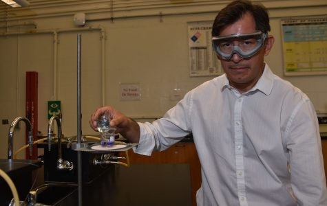 Juan Carrera-Espinoza combines two solutions in a chemistry lab on Tuesday, Aug. 30, in the Physical Science Building on City College's East Campus. Carrera-Espinoza started at City College taking non-credit courses in chemistry as a student and is now a full-time instructor.