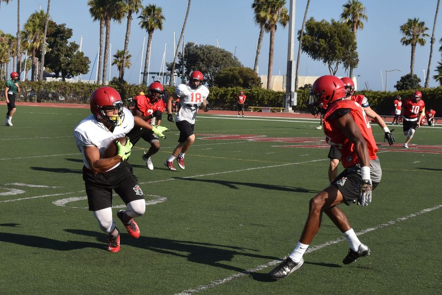 City College defensive back Rhomel Fields(right) prepares to tackle wide receiver Jason-Matthew Sharsh during practice on Monday, Aug. 29, at La Playa Field. The Vaqueros football regular season begins on Saturday, Sept. 3, in Ventura.