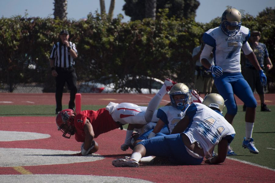 City College Wide Receiver Elijah Cunningham (no. 1) makes his way through four West Los Angeles defenders to put the Vaqueros up 35-21 in the third quarter during their home opener on Saturday, Sept. 10, at La Playa Stadium. The Vaqueros defeated the West Los Angeles College Wildcats 45-28.