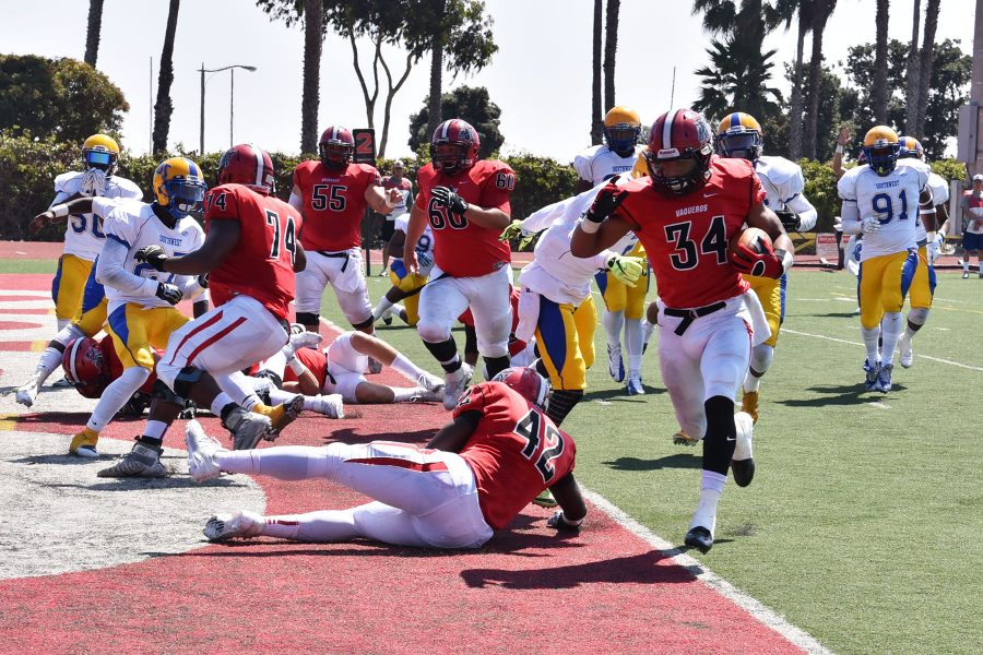Vaquero running back Perry Martin (No. 34) runs into the end zone early in the first quarter to give City College a, 14-0, lead on Saturday, Sept. 17, at La Playa Stadium. The Vaqueros crushed Los Angeles Southwest College, 51-0.