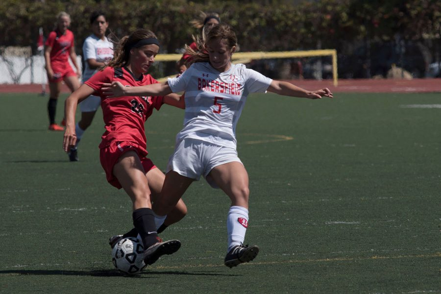 Bakersfield College defender Alexis Goyeneche (No. 5) stops City College midfielder Fee Van Deelan (No. 22) during a breakaway on Tuesday afternoon, Sept. 13, at La Playa Stadium. The Vaqueros defeated the Bakersfield Renegades 4-1.